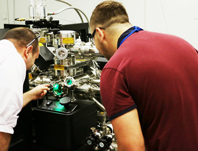 ORNL's Phil Edmondson and James Ferriday from the U.K.'s University of Sheffield use atom probe tomography to investigate the irradiation performance of low-alloy steels used in reactor pressure vessel components.