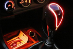 The soft glow of an LED gear shift can give an interior a futuristic ambiance.