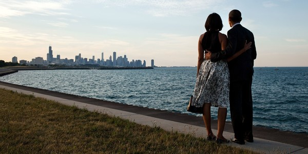 Large barack and michelle obama looking at chicago