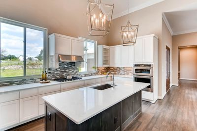 A stylish and open kitchen makes cooking as easy as possible.