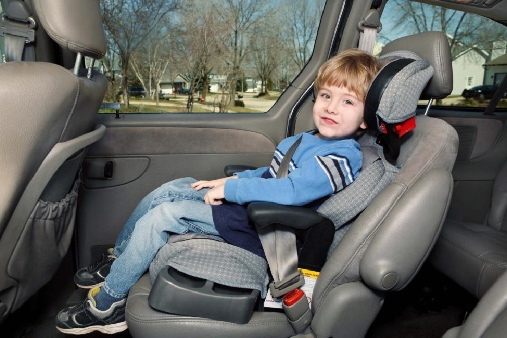 Children under 13 years old should be seated in the back seat.