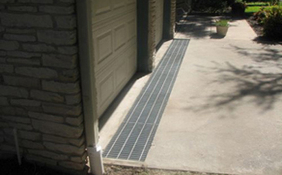 A driveway grate installed by Austin Drainage and Landscape Development