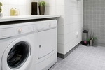A mud room can serve as a dropoff point for dirty clothes and shoes, a laundry room and a place for storage.