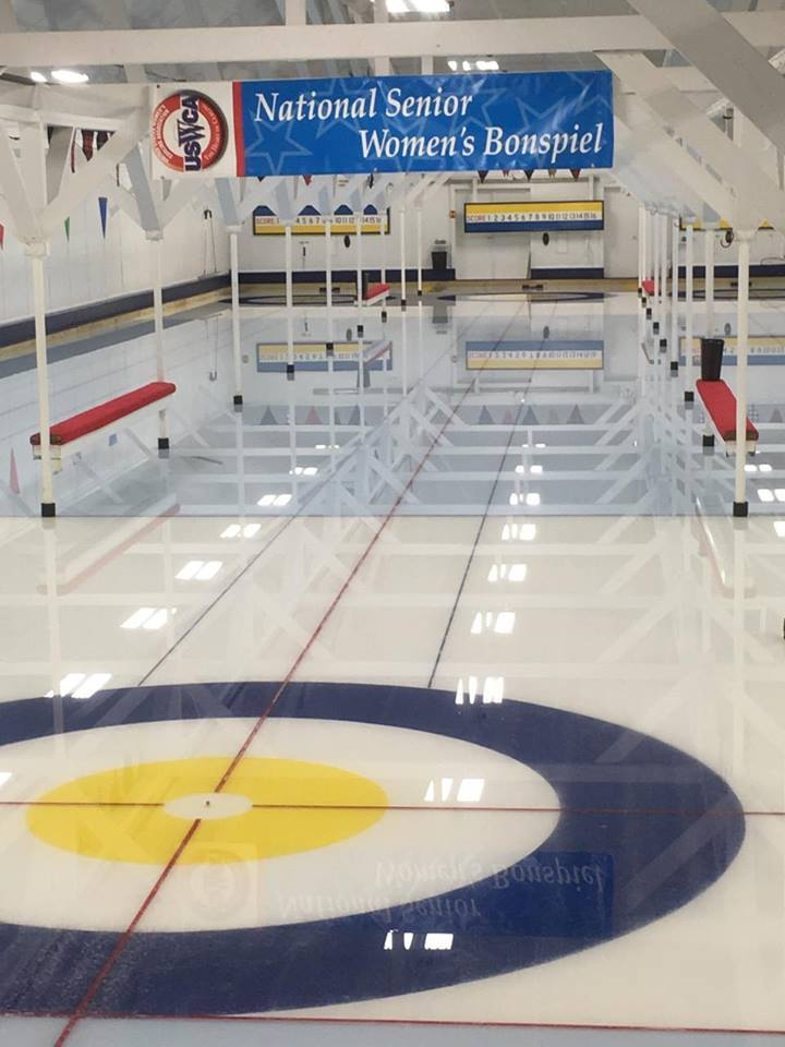 In curling, players try to slide the rock into the target area at the end of the ice.