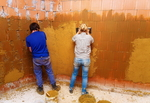 Clay plastering can be done by a novice.