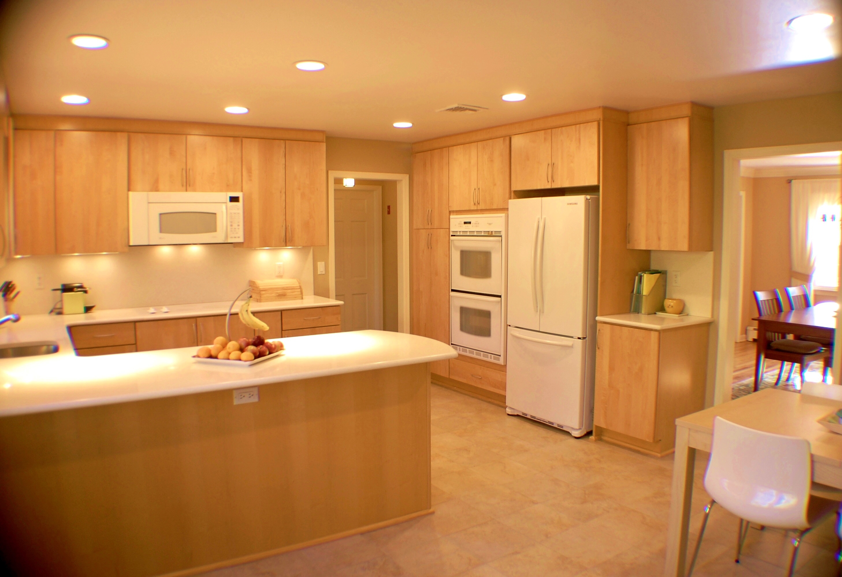 the kitchen is spacious and has an abundance of cabinetry - Commerce Kitchen