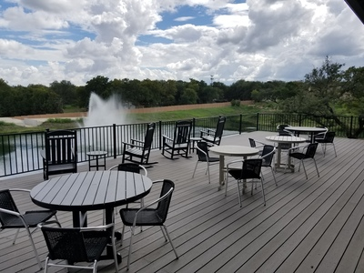 New private Amenity Center with sprawling elevated deck overlooking community pond and fountain.
