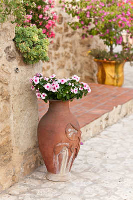 Terra cotta pots make a lovely addition to a Mediterranean-style patio.