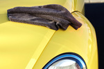 After washing your car, dry it using a chamois or soft terry towel in a back and forth motion.