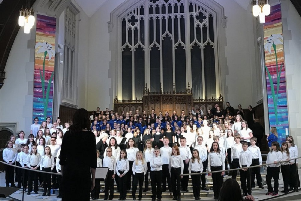 Urbandale Middle School's Sixth Grade Chorus during April's Heartland Children's Choir Meet the Composer Festival at Plymouth Congregational Church in Des Moines
