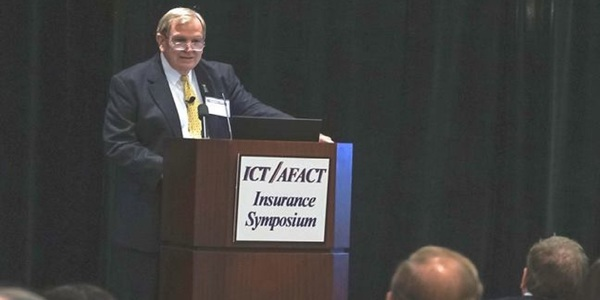 Jay Thompson, a partner with Thompson, Coe, Cousins and Irons, speaking at last year's symposium. Thompson is scheduled to participate in a panel during this year's symposium.