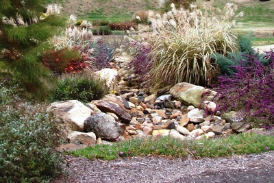 A dry creek is a decorative and practical drainage system.