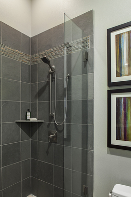 A new shower with a hand-held shower head and built-in shelves to hold toiletries are very in style.