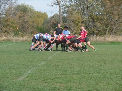 Two high school rugby teams contest a scrum during a 2016 game.