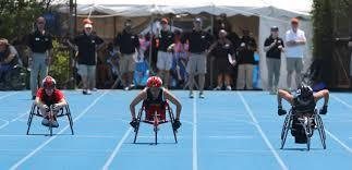 Athlete compete in a wheelchair at the state combined track and field finals at Eastern Illinois University in Charleston.