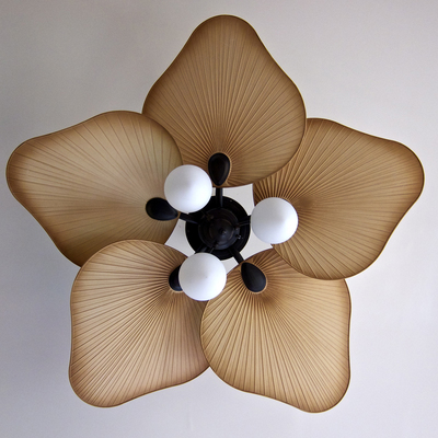 In addition to relief from the heat, ceiling fans can be a decorative home item.