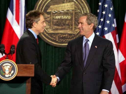 Then Prime Minister of the United Kingdom, Tony Blair shaking hands with President of the United States, George W. Bush, after they conclude a joint news conference at the Camp David