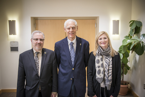 Senior Vice President for Academic Affairs and Provost James P. Lentini, left, with Dr. Frank Giblin and Dr. Terri L. Orbuch at the Board of Trustees meeting approving their elevation to Distinguished Professors at Oakland University.