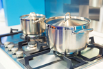 When boiling water, remember to cover the pot as it will both cut down on the heat and result in faster boiling.