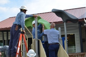 SCE&G volunteers put the finishing touches on the new One80 Place playground donated by the utility company.