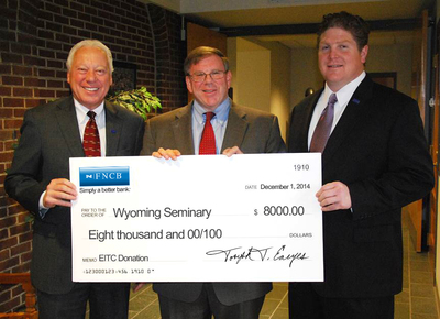 FNCB representatives present an $8,000 Education Improvement Tax Credit (EITC) donation to Wyoming Seminary Prep School, which will use the money for scholarships. From left are Joseph Earyes, first senior vice president; John Shafer, Wyoming Seminary Pre
