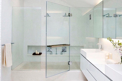 Many homeowners are trading in the dull shower curtain for an elegant glass option.