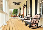A ceiling fan on the patio can help you stay cool, even as you enjoy your outdoor space.