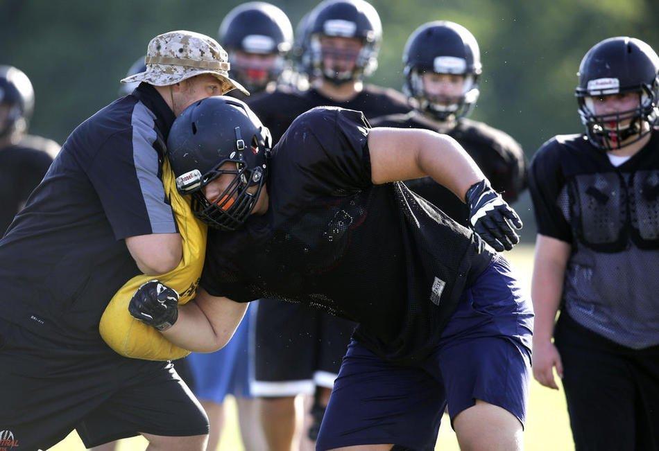 Crystal Lake Central's Wyatt Blake runs drills during summer training.