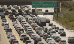 Traffic clogs the 405 Freeway in the Sepulveda Pass on a recent afternoon. Vehicles produce 40% of California's air pollution, but Trump wants to roll back emission standards.