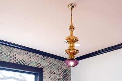 A custom light fixture can not only shine light, but provide
