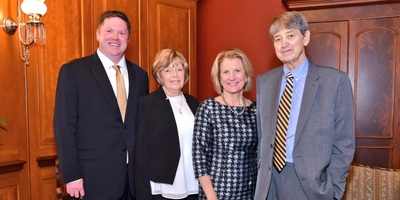 Tom Kleeh (left) and his parents meet with Sen. Shelley Moore Capito.