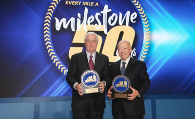 Roger S. Penske, left, chairman of Penske Transportation Solutions, and Brian Hard, president and CEO, pose for a 50th anniversary photo.