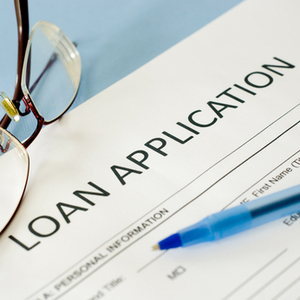 The loan would be fully paid in seven years with a 2 percent interest rate and secured by a first mortgage on the property along with a personal guarantee.