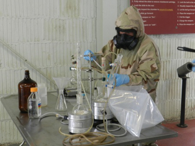 A 22nd Chemical Batallion soldier conducts a capabilities demonstration.