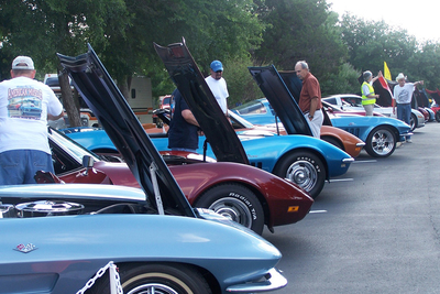 Visitors to last year's GTACC car show wander among a fleet of Corvettes on display.