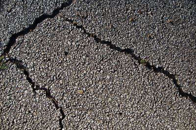 Cracks like this in an asphalt driveway can let water into the substructure, which could cause problems.