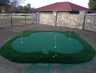 A backyard putting green is a great addition to the yard for homeowners who enjoy golf.