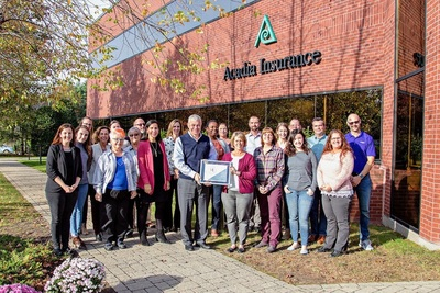 Employees of Acadia Insurance, a Berkley Company, pose with the Mindful Employer Designation. This honor was awarded by Acadia employees via the Mindful Employer organization based on its stringent standards for achieving this recognition.