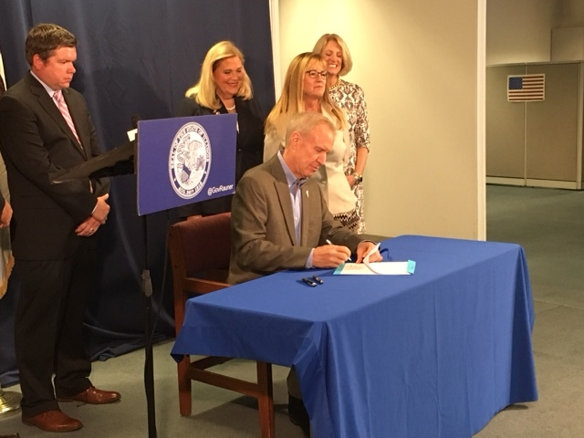 Gov. Bruce Rauner signs House Bill 162, which is meant to provide more transparency to the EDGE program.