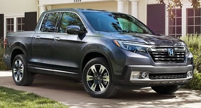 The Ridgeline has an available 150W/400W truck bed power outlet.