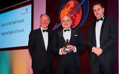 Fawzi Al Dajani (center), NBK London General Manager, accepts the award on behalf of the company.