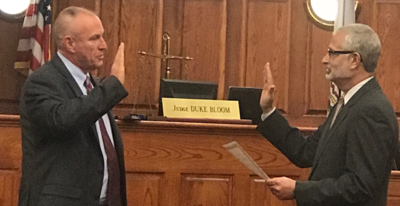 Magistrate Jesse Bailes getting sworn in by Chief Judge Louis Bloom