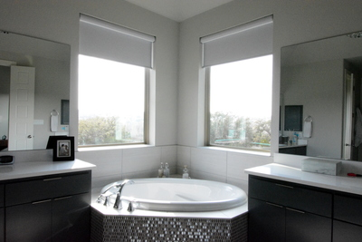 Subtle shades in the bathroom allow privacy without compromising light or style