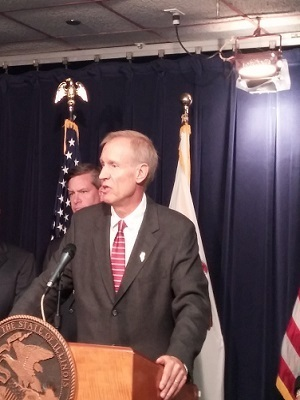 Ill. Gov. Bruce Rauner responds to questions at a press conference Sept. 10, 2015, in Chicago.