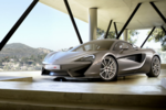 The McLaren is breathtaking, whether on the road or in a showroom.
