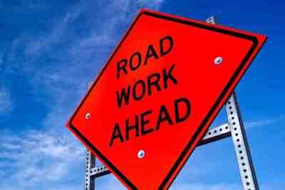 Medium road work sign orange