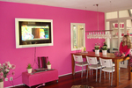 Neutral colors in the home's interior are giving way to vibrant colors, even as far as hot pink.