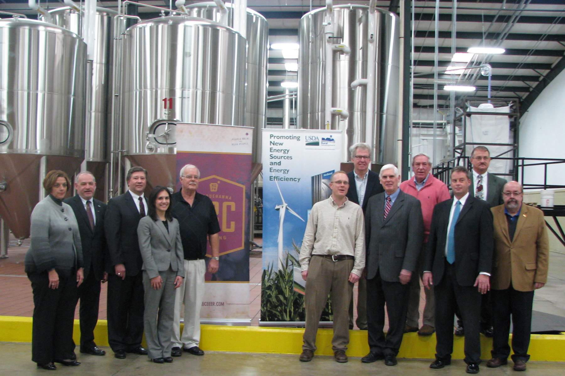NEPA officials present Susquehanna Brewing Company officials with a $140,000 federal loan.