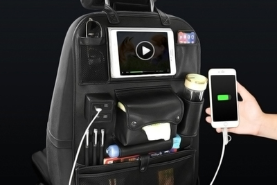 This seat back organizer includes a charging port to keep devices charged up.