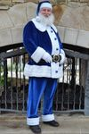 Guy Benson, 58, delivers toys and meals to needy families' homes while wearing a blue suit and the same boots that police officers wear.